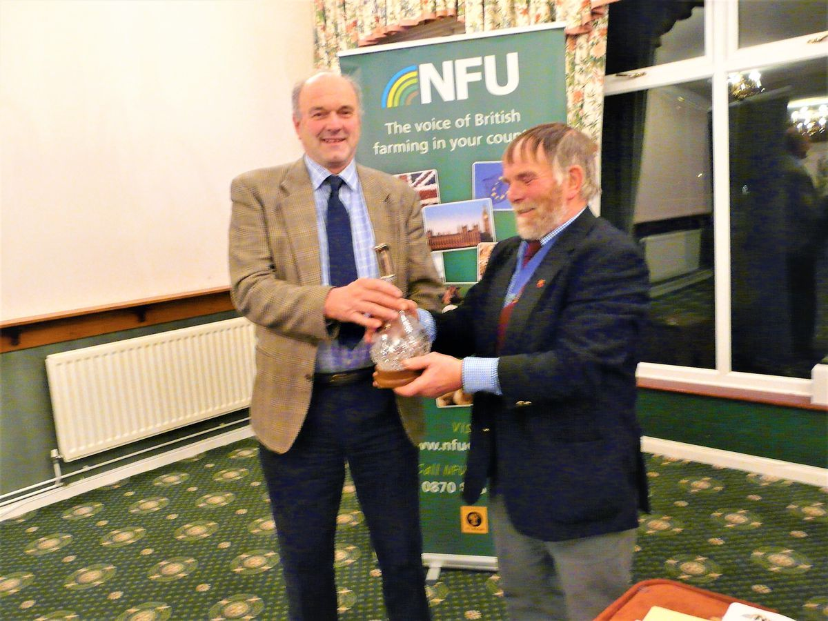 Graham Clay receives the Burton trophy from Staffs NFU chairman Richard Spencer