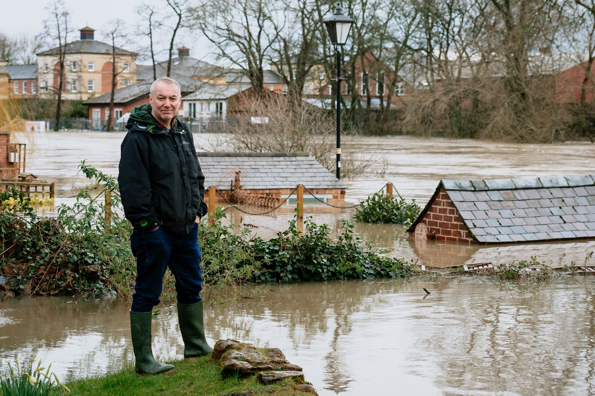 Chris Allen in St Julian's Frairs, Shrewsbury where his garden and property are under water
