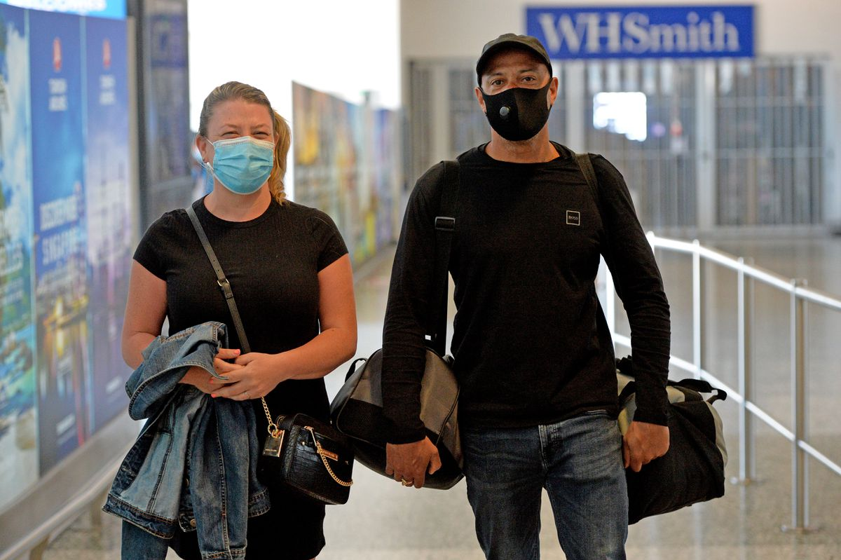 Zoe and Wayne Parris arrive from Portugal