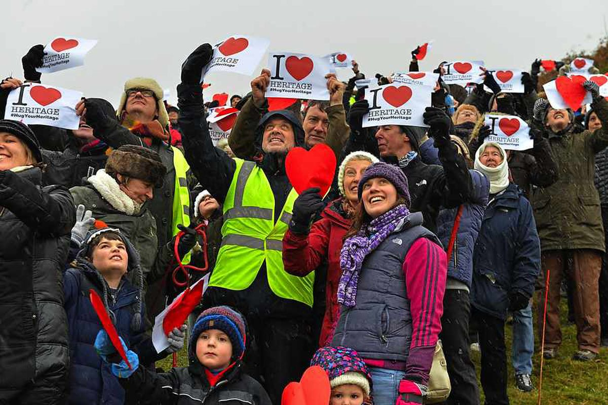 Hundreds brave elements to show love for Oswestry Hillfort