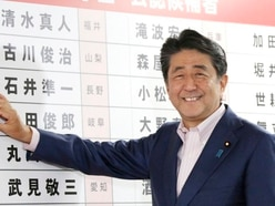 Japan's ruling coalition secures upper house majority