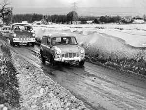 """nostalgia pic. Wellington. """"The scene today on the Wellington to Dawley Road, where a 200-yard drift is thought to have covered several abandoned cars,' is the caption pasted on the back of this print in the Shropshire Star picture archive, which was taken on January 10, 1968, and published same day. The print has the Shropshire Star copyright stamp and the photographer was 'BS' which will be Brian Swindells. Winter scene. Wintry scene. Snow. Ice. Freeze up. The leading vehicle is a Mini van followed by a Ford Transit (I think, definitely Ford). Library code: Wellington nostalgia 2020.."""