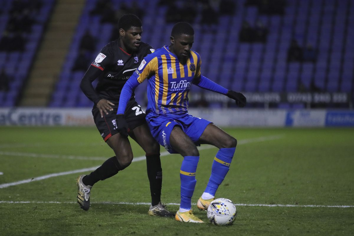 Timothy Eyoma of Lincoln City and Shilow Tracey of Shrewsbury Town. (AMA)
