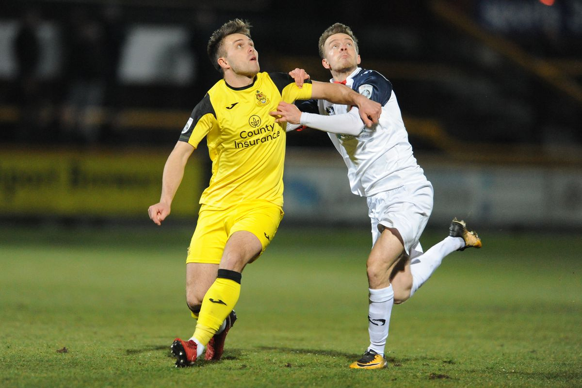Elliot Newby battles for the ball with Jordan Richards of Southport