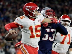 Mahomes injures throwing hand but Chiefs into playoffs after beating Patriots