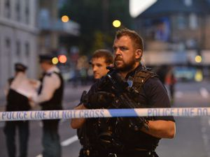 File photo dated 19/06/17 of armed police officers man a cordon in Finsbury Park, north London