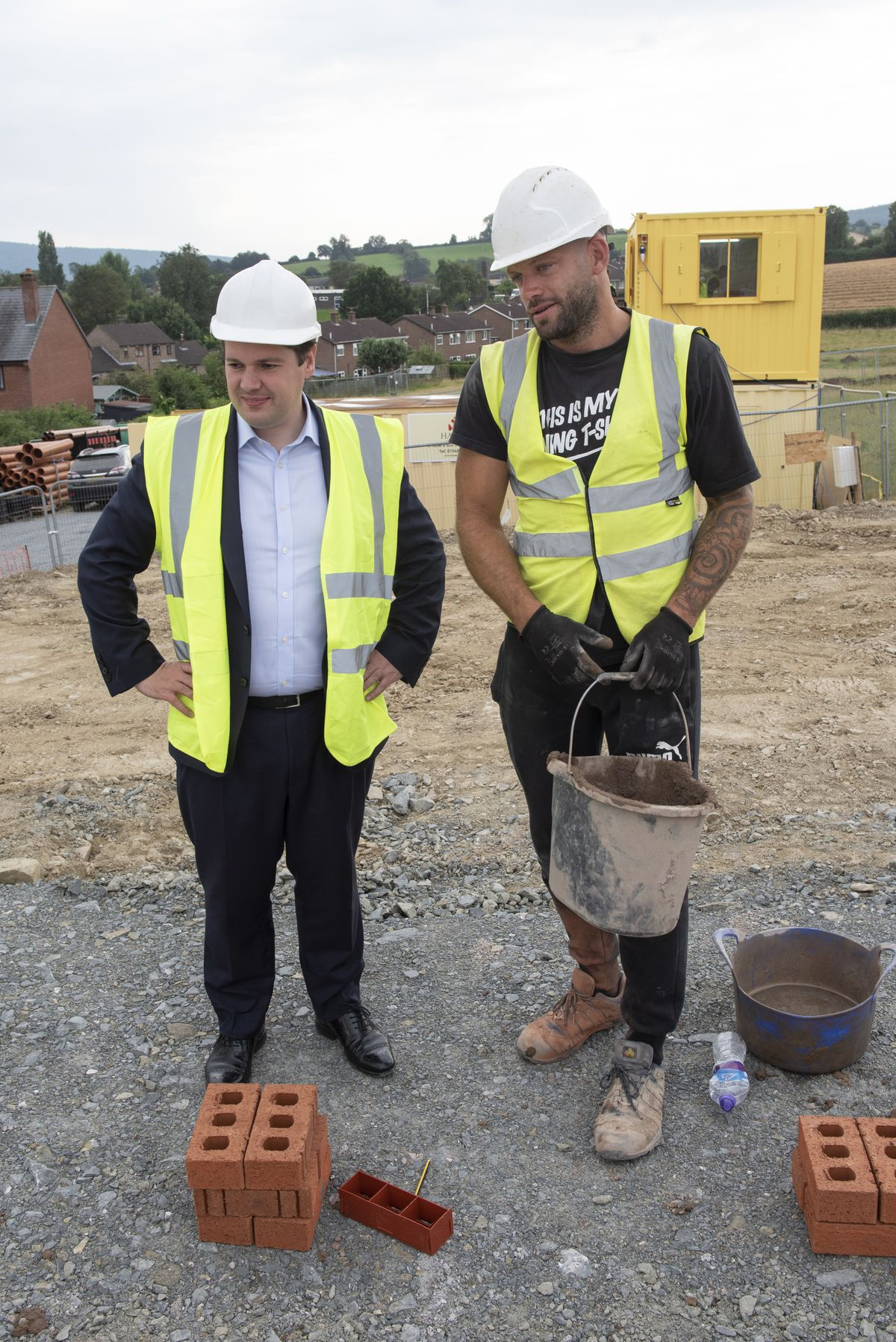 Secretary of State for Housing, Communities and Local Government, Robert Jenrick MP with a bricklayer from contractor J. Harper