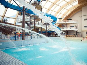 Blue Lagoon water park with pools, wave machine, water slides and artificial beach.