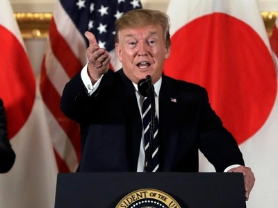 Donald Trump arrives in Tokyo for state visit, golf and sumo