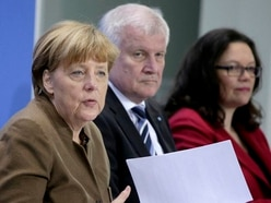 German government seeks to end stand-off over spy chief