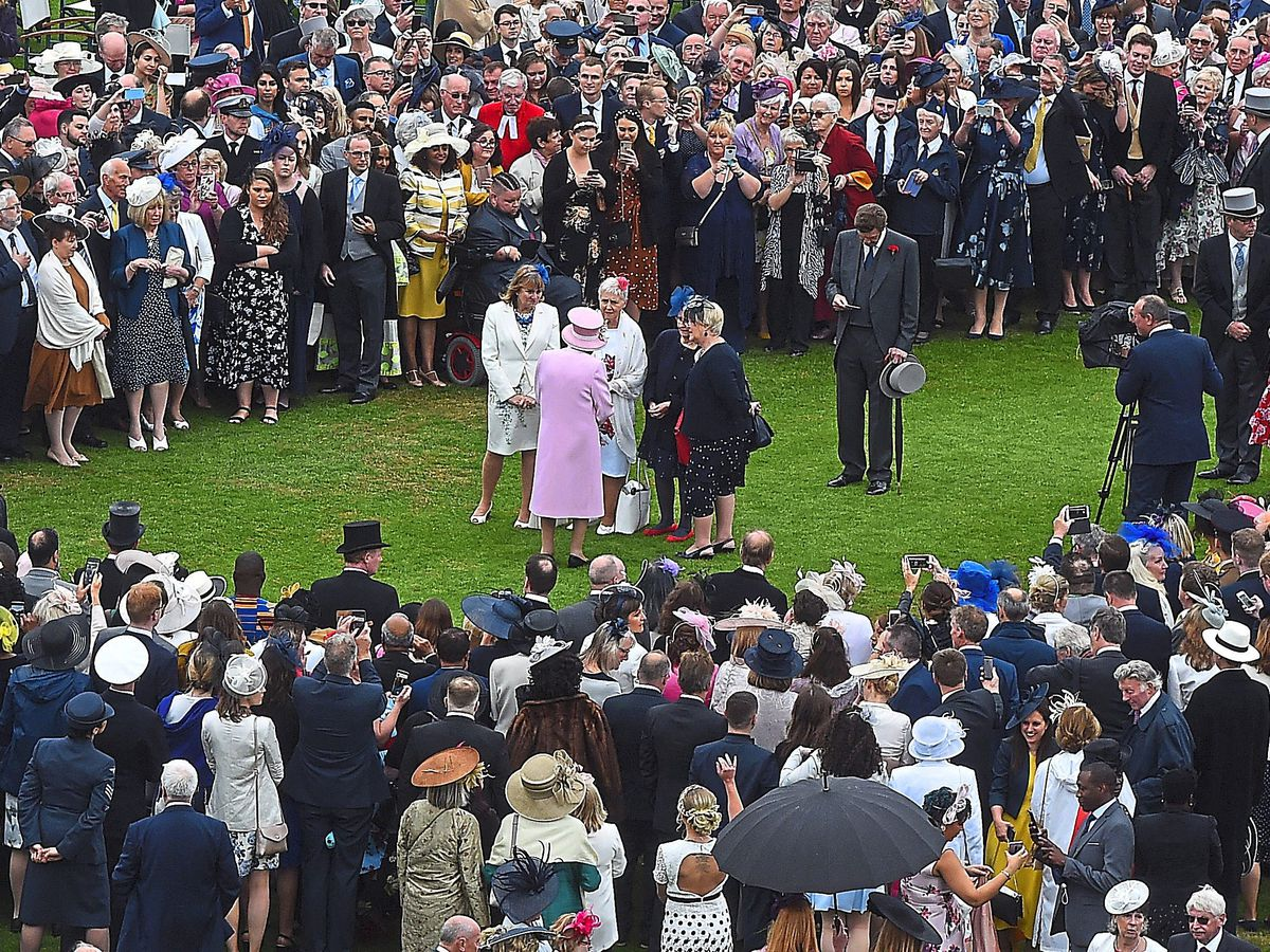 The Queen greets guests at the Royal Garden Party at Buckingham Palace on Wednesday