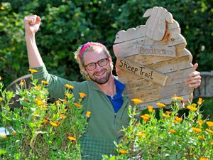 NORTH COPYRIGHT EXPRESS&STAR TIM THURSFIELD-21/09/20.A new sheep trail is proving popular at Fordhall Organic Farm, Market Drayton. Children have to look out for sheep shaped plaques along Pictured holiding one of the plaques to be found is youth worker Mike Grabarz..