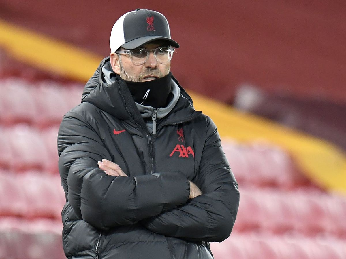 Liverpool manager Jurgen Klopp folds his arms and looks thoughtful