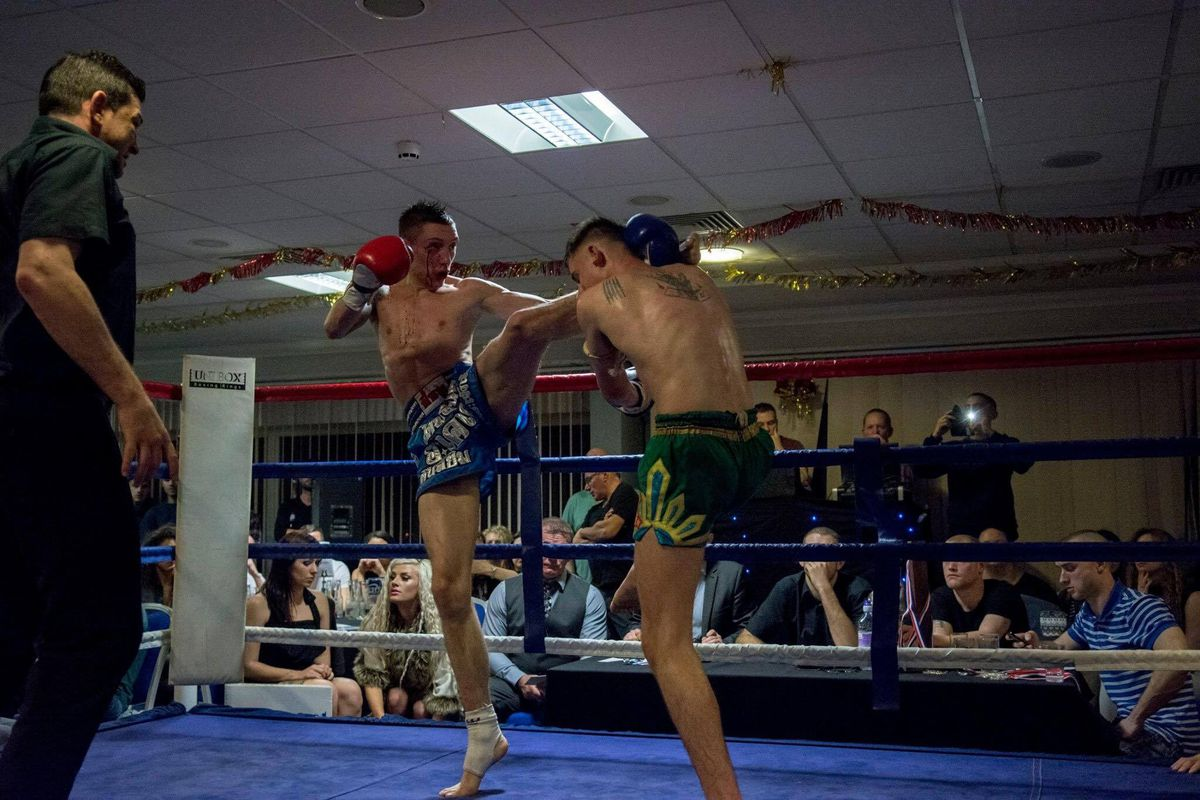 Luke in Muay Thai action in the boxing ring