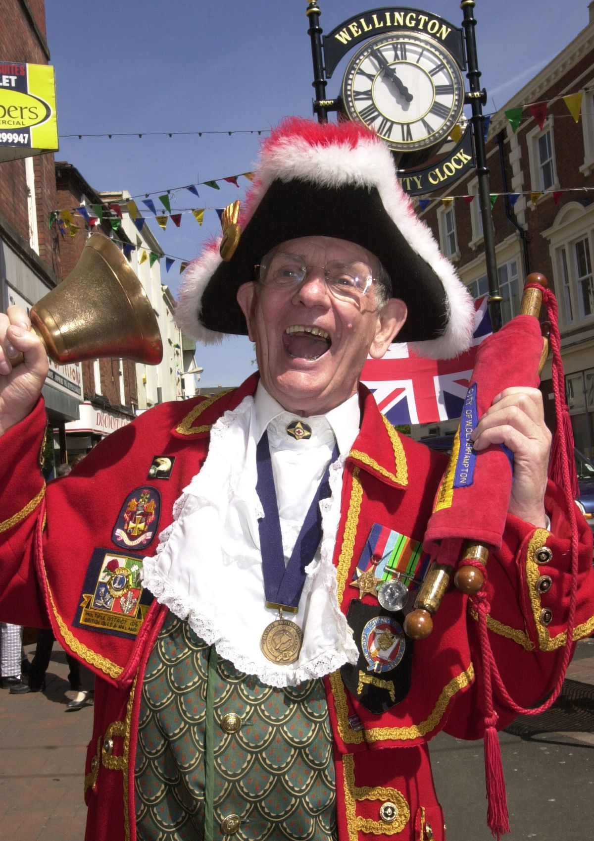 Town crier Percy Simmonds in full voice in Wellington town centre during the 2002 Golden Jubilee