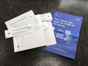 A package of NHS Covid-19 self-testing kits