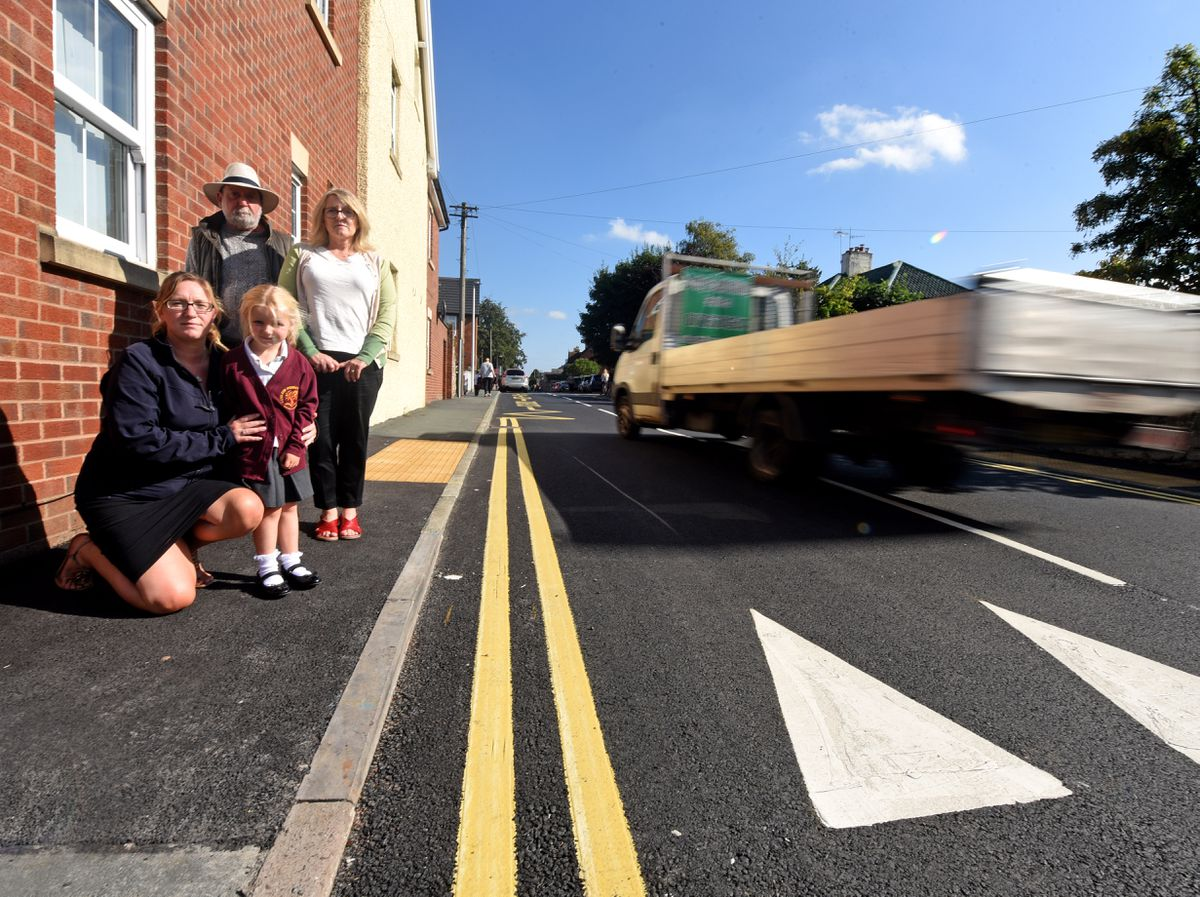 SOUTH COPYRIGHT MNA MEDIA TIM THURSFIELD 15/09/21 .Parents have complained about the new speedbump outside Ludlow Primary School. They say it's actually speeded the cars up rather than slow them down..Pictured is parent governor Nicky Stewardson with her daughter Lillie, aged 4, Andy Boddington from Shropshire Council and councillor Tracey Huffer...
