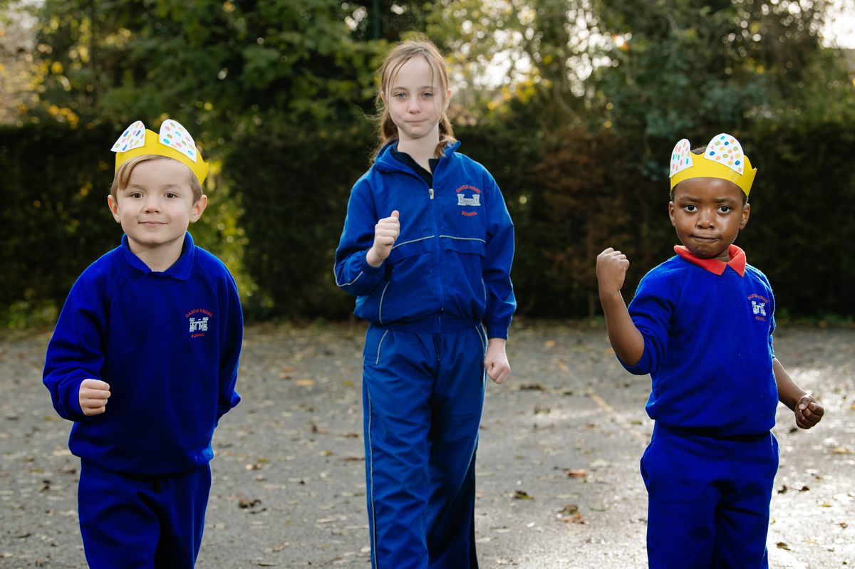 Children of Castle House School in Newport last weekend walked many miles of their playground to raise money for Children in Need. From left to right are Joey Romani-Arnold, five, Madison Paton-Faver, 10, and Tiriwashe Nyamwanza, three.