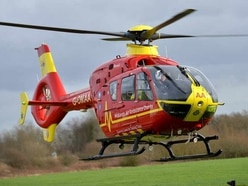 Woman airlifted to hospital after being hit by car as she got off bus