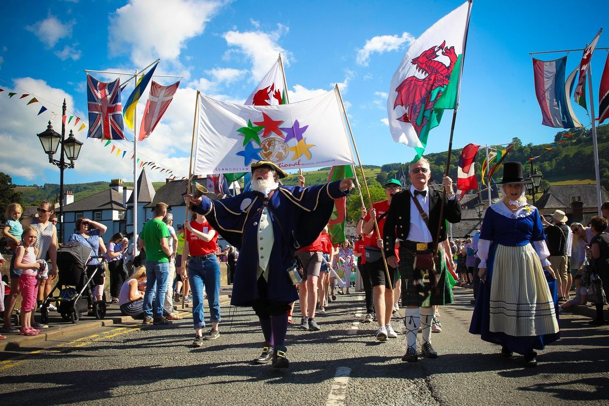 Parade of Nations draws crowds as the procession walks through Llangollen town centre