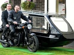 Morris Minor and Triumph motorbike hearses on show at Shrewsbury funeral directors