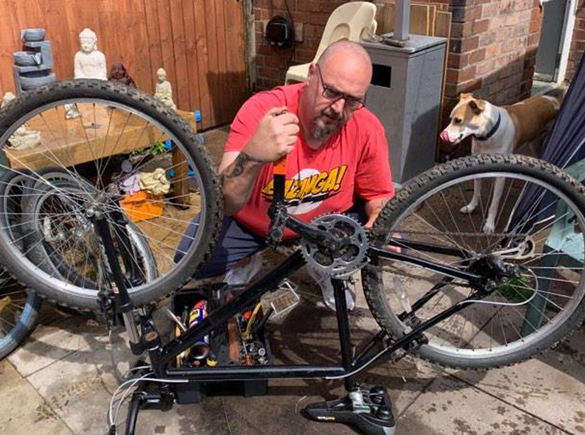 Colin Davies, of St Georges, Telford, has set up (launched April 2021), a scheme called Bikes 4 Kids in which people donate old bicycles and he does them up and gives them away to youngsters whose families have been hard hit by the pandemic. His number: 07920 804674. He is pictured working on one of the bikes..
