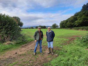 Richard Huffer and Jon Reardon-Smith at the field nearest Squirrel Lane