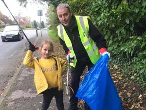 Rob Palin and his daughter Tillie, seven, who often helps him as he goes out litter picking.
