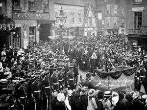 nostalgia pic. Bridgnorth. 'Proclamation of King George V, Bridgnorth, May 12/10. Powell Photo.' i.e. the proclamation of the new King in Low Town, Bridgnorth, on May 12, 1910. Bridgnorth street scene, general view. They are in front of the Falcon Hotel with Weavers stores on the far right. This is a postcard and the message on the back reads: 'Dear Annie, What do you think of this shouldn't you like to have been there when this was taken love from Auntie Doris/Davies (or something like that, last word difficult to read).' It was addressed to Miss Annie Taylor, Blundell, Stottesdon, Cleobury Mortimer, Salop. However there is no stamp or franking mark. This is from the large collection of Bridgnorth photos and other historical material which were accumulated by John Dixon, of Low Town, Bridgnorth. Mr Dixon died on June 29, 2017, aged 72. He originated from Wednesbury and came to Bridgnorth in 1978. The collection is being looked after by his son Michael Dixon (and this copied with Michael's permission on Tuesday, May 15, 2018). 0777 9631952 of Low Town, Bridgnorth. michael@michaeljdixon.com. Library code: Bridgnorth nostalgia 2018..