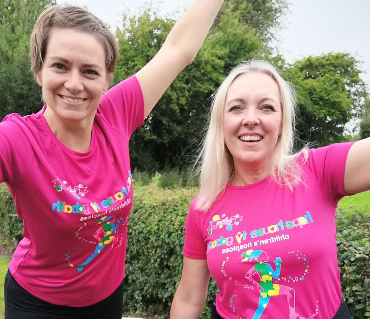 Members Lucy Drury and Esther Evans show off their #HopeHouseMiles shirts