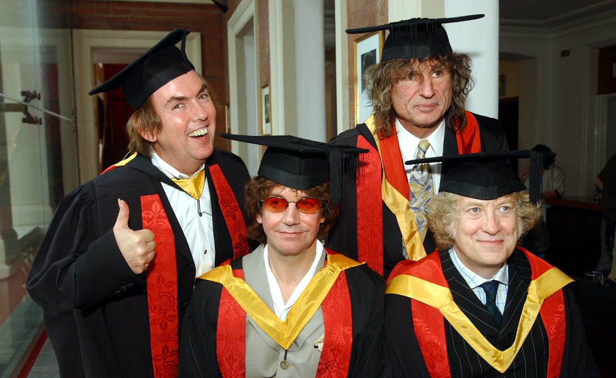 Noddy Holder, Dave Hill, Jim Lea and Don Powell, collect their honorary followships from their home town University of Wolverhampton