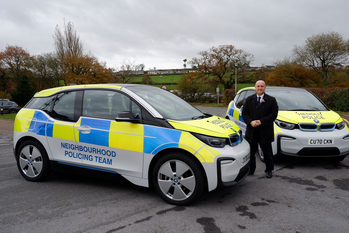 Police and Crime Commissioner Dafydd Llywelyn with Mid Wales' green police cars