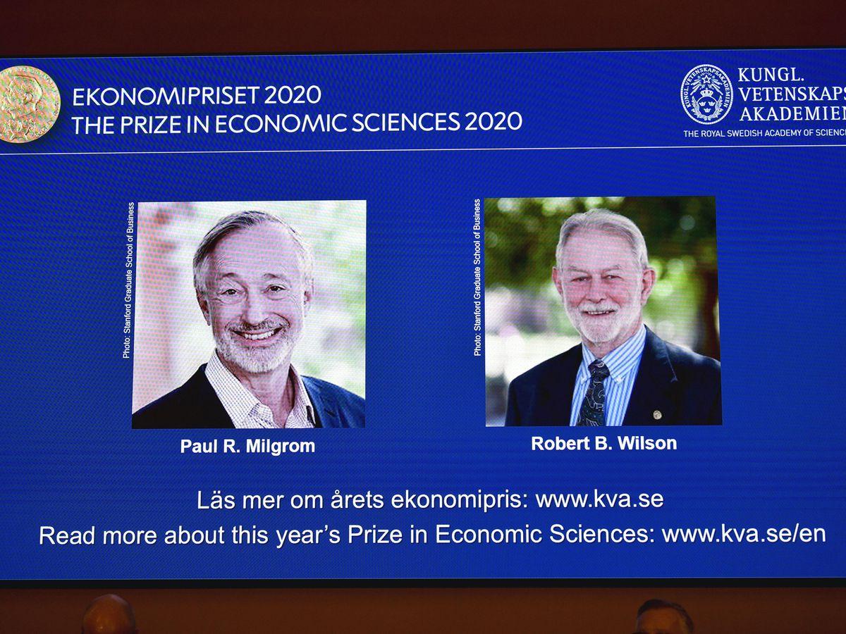 Winners of the Nobel Prize in Economic Sciences Paul R Milgrom, left, and Robert B Wilson