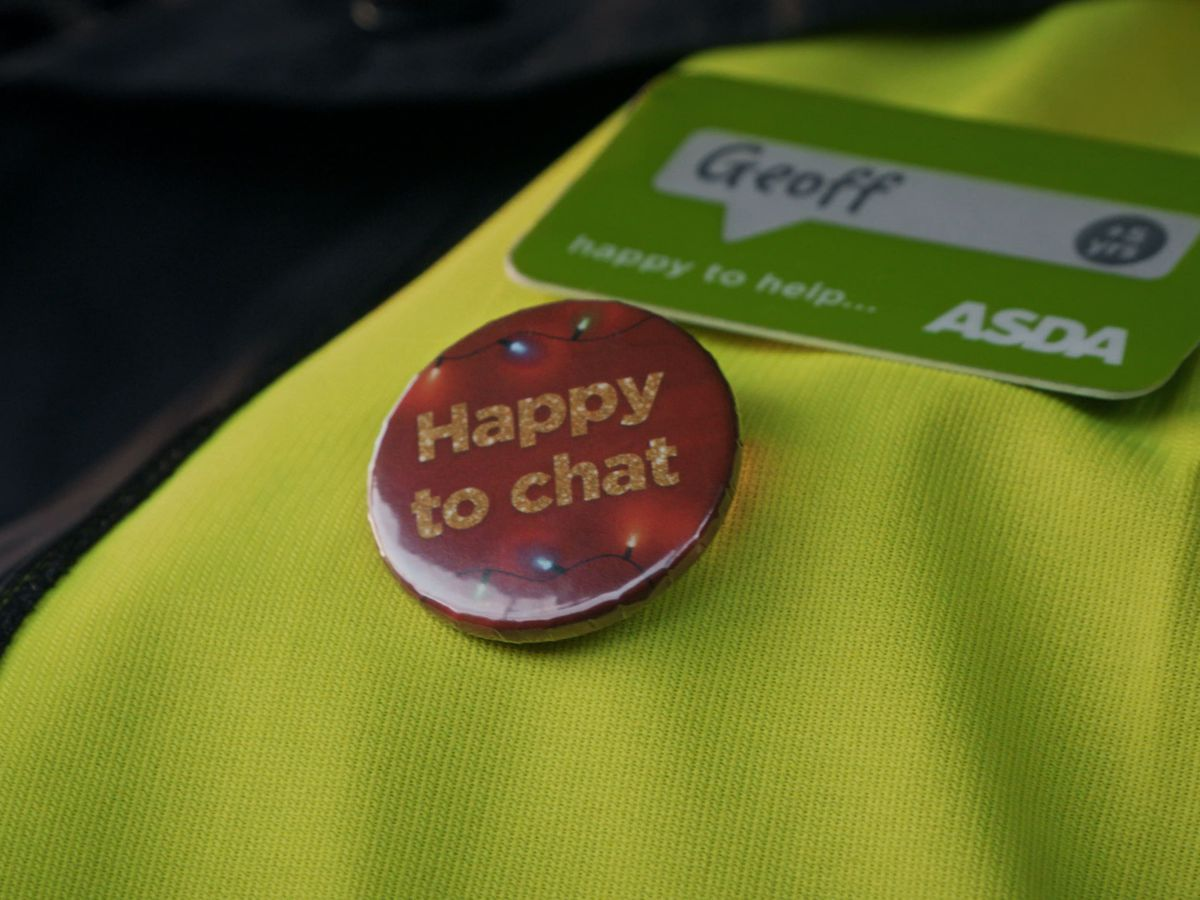 A badge which reads 'Happy to chat' that Asda delivery drivers can wear on their uniforms to help combat loneliness