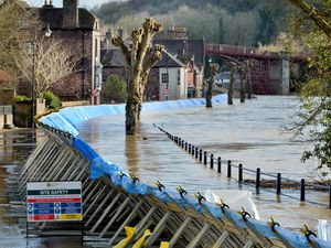 The River Severn being held back by the flood defences in Ironbridge in January