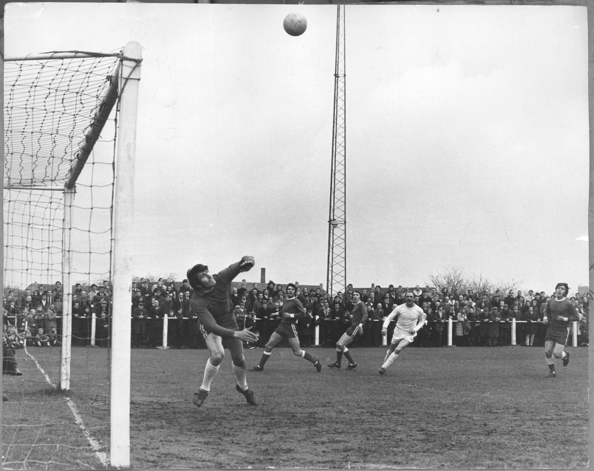 Telford United legend Jack Bentley lobs the ball over the Tamworth keeper during the 1971 FA Trophy run