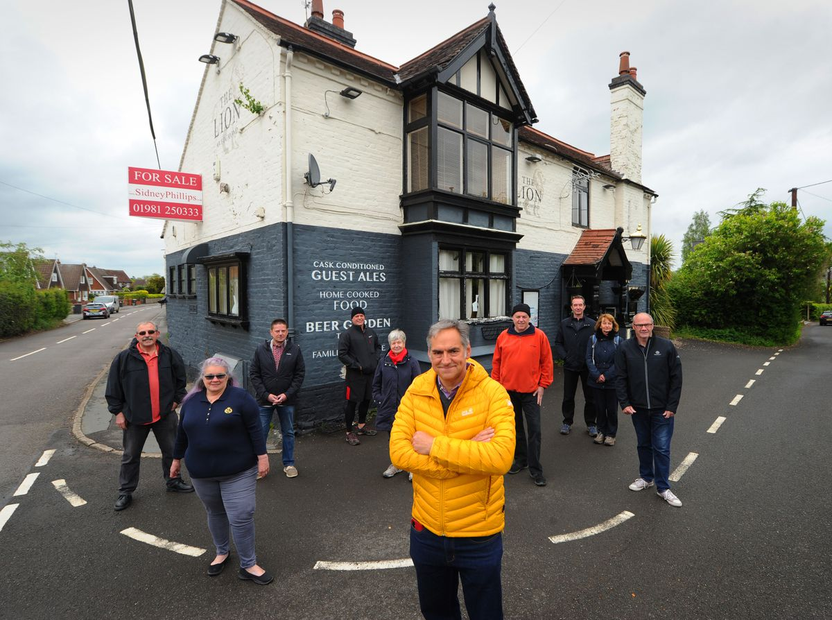 Members of the Lion Roars Again Campaign Group, including (front) chair Rod Roman, hoping to buy The Lion At Edgmond