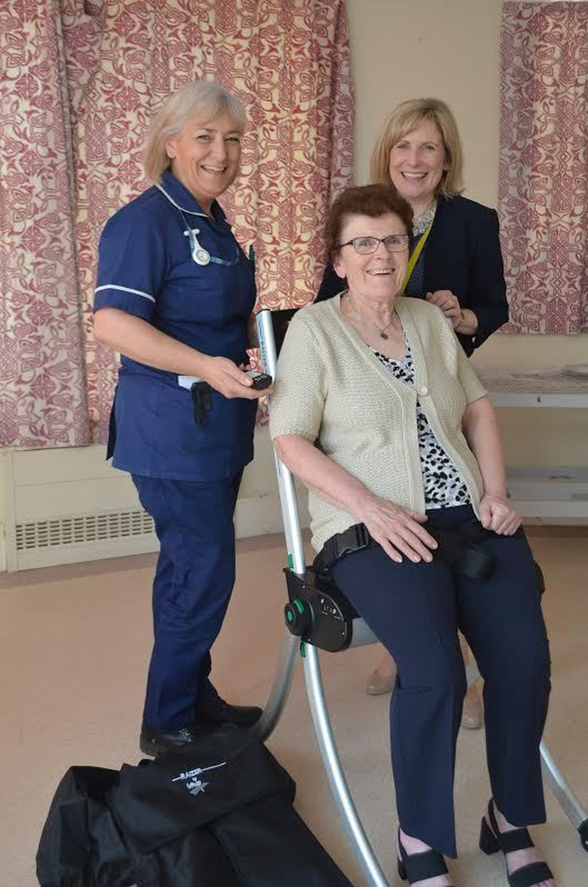 Testing the chair are from left, Linda Head, Moving and Handling Co-ordinator at Orthopaedic Hospital, Elaine Tinsley, Accounts Officer and Victoria Sugden, Charity Director of The League of Friends.