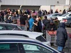 In Pictures: Coronavirus contrast of empty motorways and supermarket queues