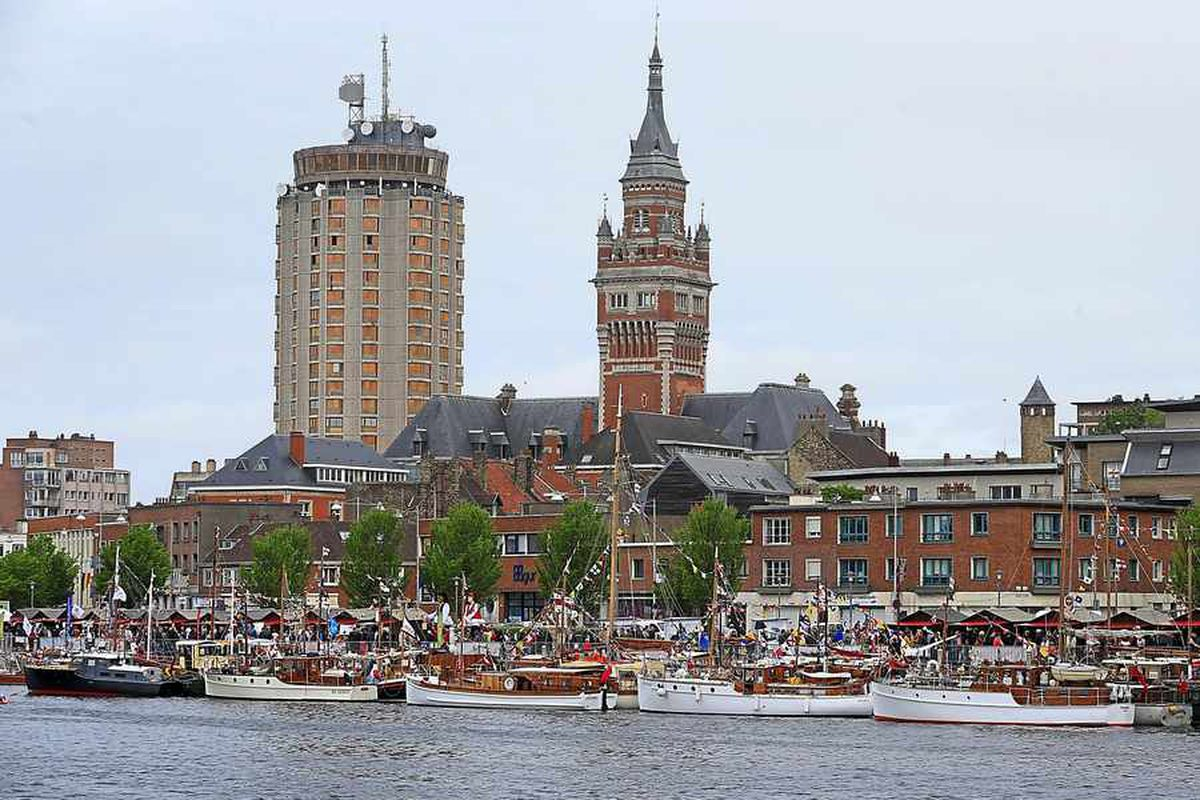 The 'little ships' moored in the harbour during a military parade through Dunkirk in May