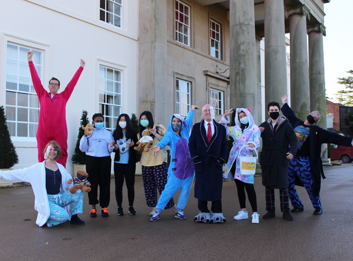 Students and staff taking part in Concord College's pyjama day