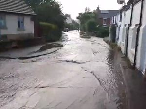 Water flows down Station Road in Pontesbury. Photo: Shrewsbury Police