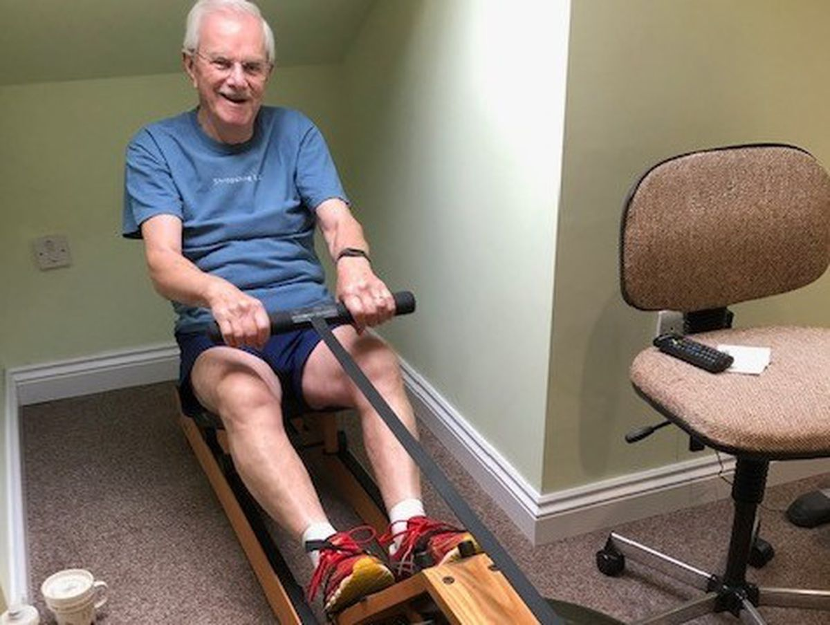 Pat Lewis completing the rowing section of the challenge