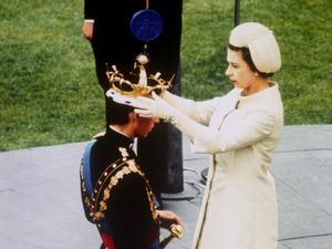 File photo dated 01/07/1969 of Queen Elizabeth II crowning her son, Prince Charles, as Prince of Wales during the investiture ceremony at Caernarfon Castle. PRESS ASSOCIATION Photo. Issue date: Monday January 9, 2012. The 1960s dawned with the Queen giving birth to her third child, with Prince Andrew coming into the world on February 19 1960. The decade ended with the investiture, at Caernarfon Castle of the Prince of Wales. In the years in between, Britain and the world went through a culture shock. The baby-boomer generation was growing up, spending money and making their impact in the world. See PA ROYAL Jubilee stories. Photo credit should read: PA Wire
