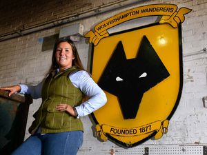 Kaylee Brown, from Perton, is part of the family that are selling two iconic signs that once hung high at Molineux