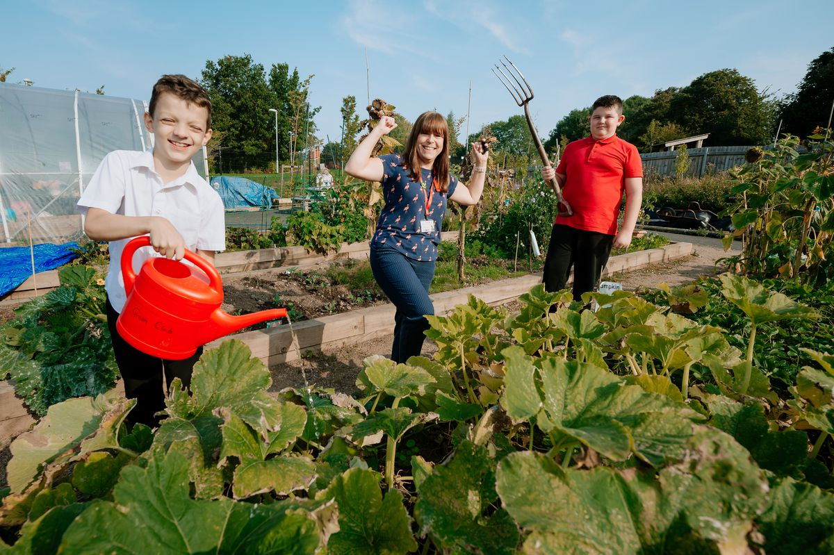 Caden Westwood, eight, Caroline Hounsell, and Jack Davies 10, of Grange Park Primary School, in Telford, celebrate the Virtual Shrewsbury Flower Show school award