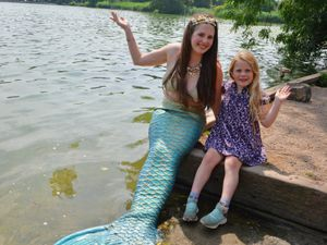 Mermaid Seren Jeni Hall, of Gobowen, at The Mere, Ellesmere, with Jemima Jones, aged seven, of Ellesmere