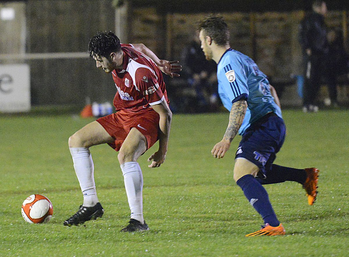 Drayton player (red) Lyndon Campbell.