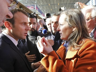 French farmers give Macron a rough ride over policies at agriculture fair