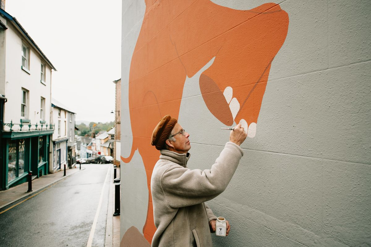 An Elephant mural has been painted on the side of the Bishop Castle Town Hall by Bamber Hawes of Bishops Castle